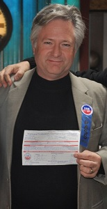 Kirk Harnack (KD5FYD) holds his temporary General Class Amateur license.