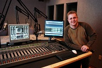 Way Media's Jon Garrison shows off an Axia Element console at WAY's Nashville studios.