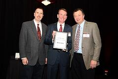 COO Scott Stiefel and CEO Frank Foti accept honor