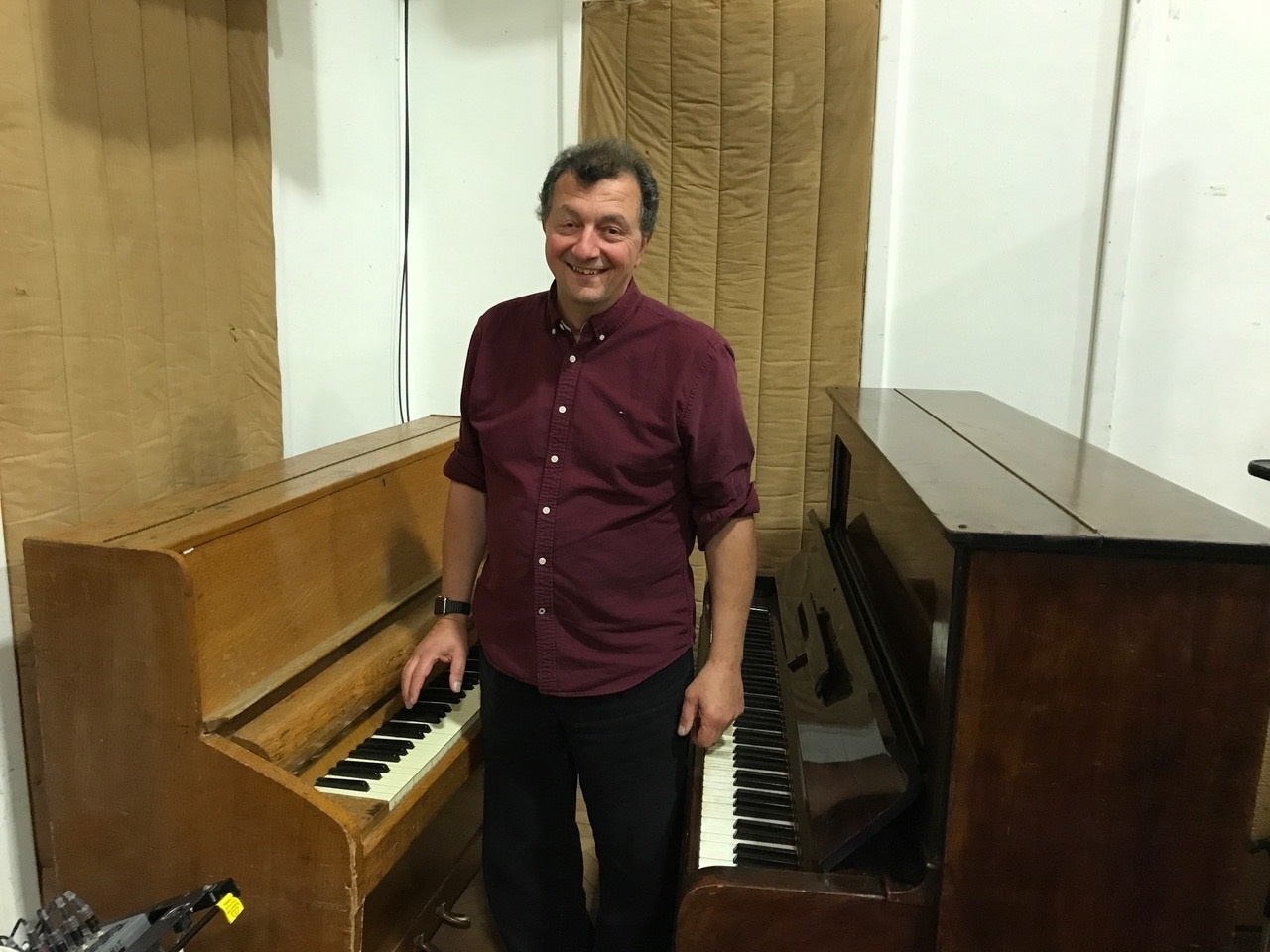 "Frank between pianos used for the Beatles' ""Get Back"" and John Lennon's ""Imagine"""