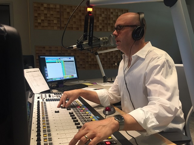 Program Host David Aus at the Fusion console