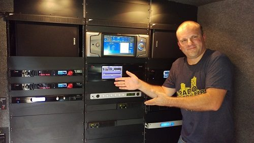 Dave Collins displays the Wall of Omnia in the Telos Alliance van