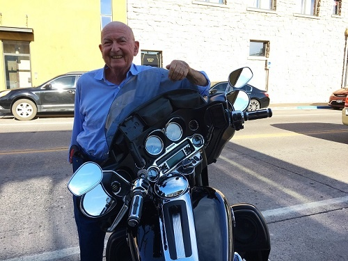 Saul Levine poses with a Harley