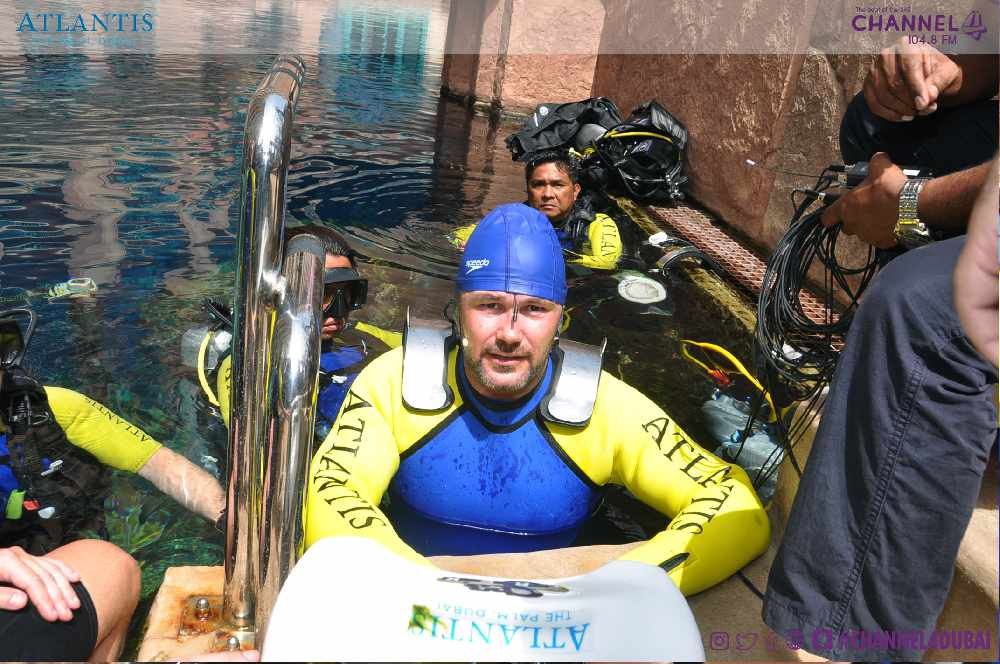 Channel 4 FM's Stu gets in the pool for underwater broadcast
