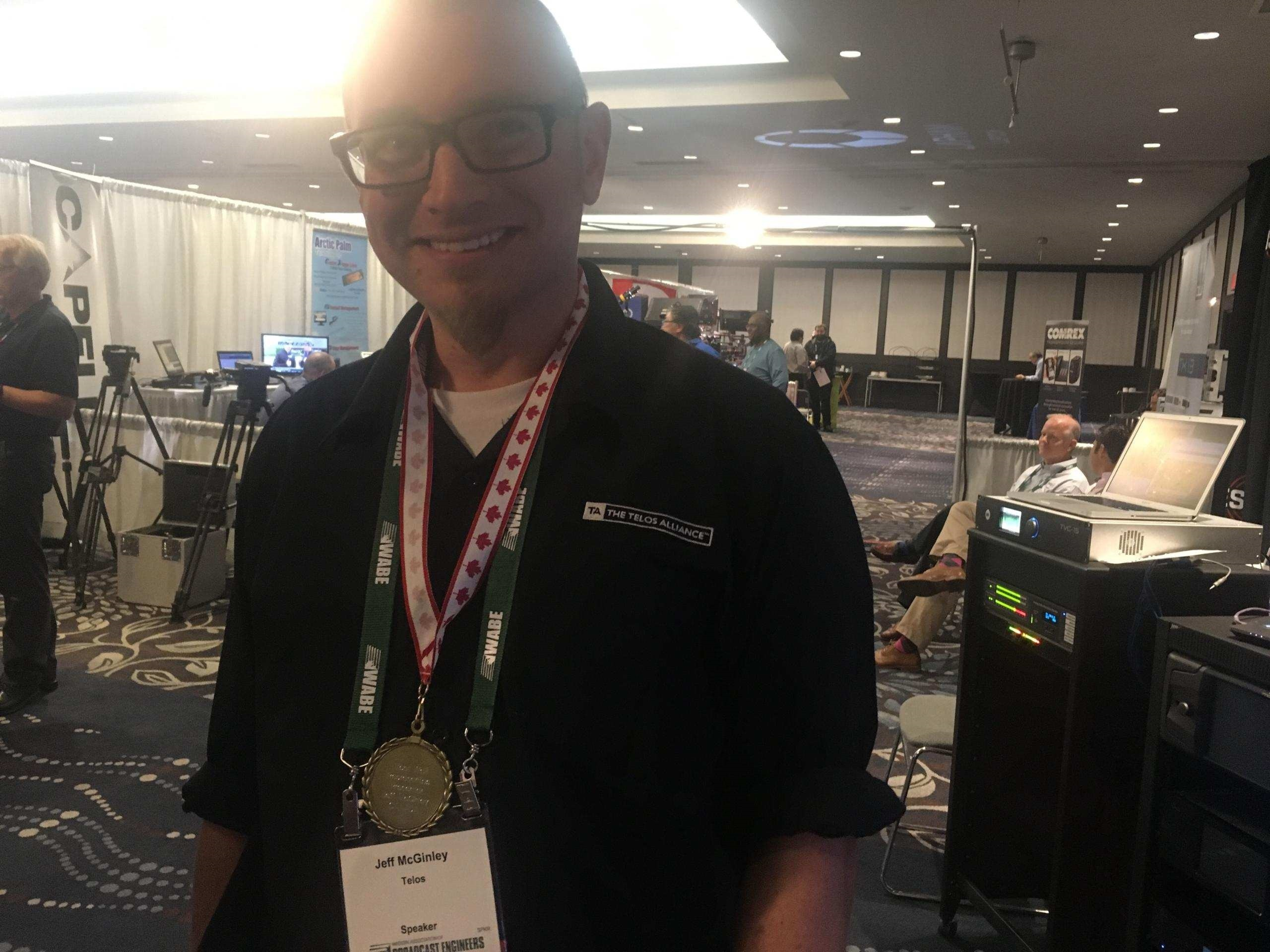 Jeff shows off his medal