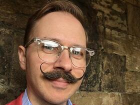 Jason sporting a handlebar moustache