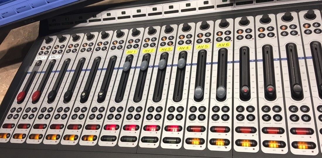 Axia Element console with red and gray fader caps at NETV
