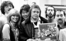 Frank (top left) with John Gorman (center) and the WMMS crew
