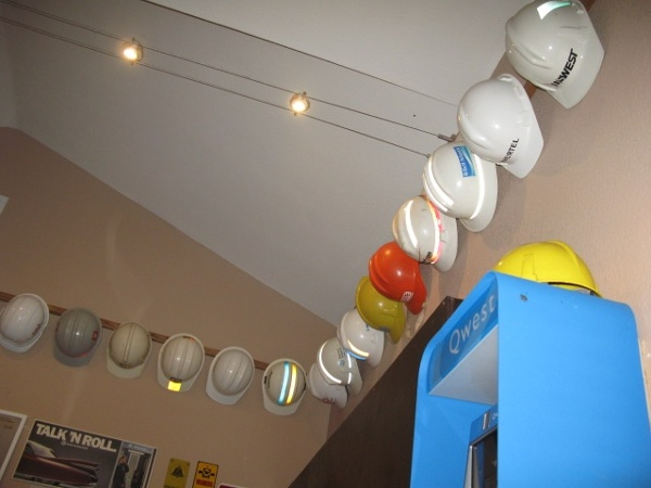 Hard hats hung neatly on the wall