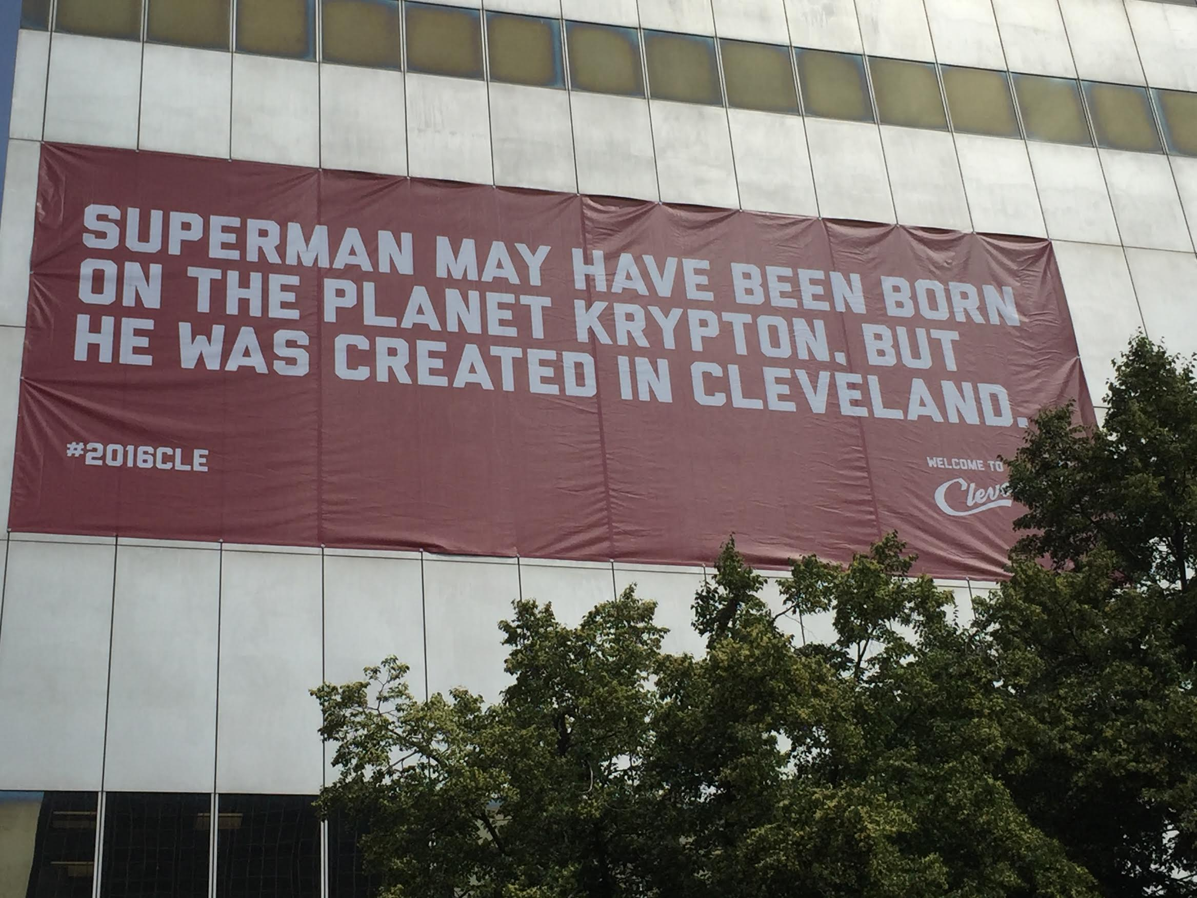 Superman banner hangs from a downtown building