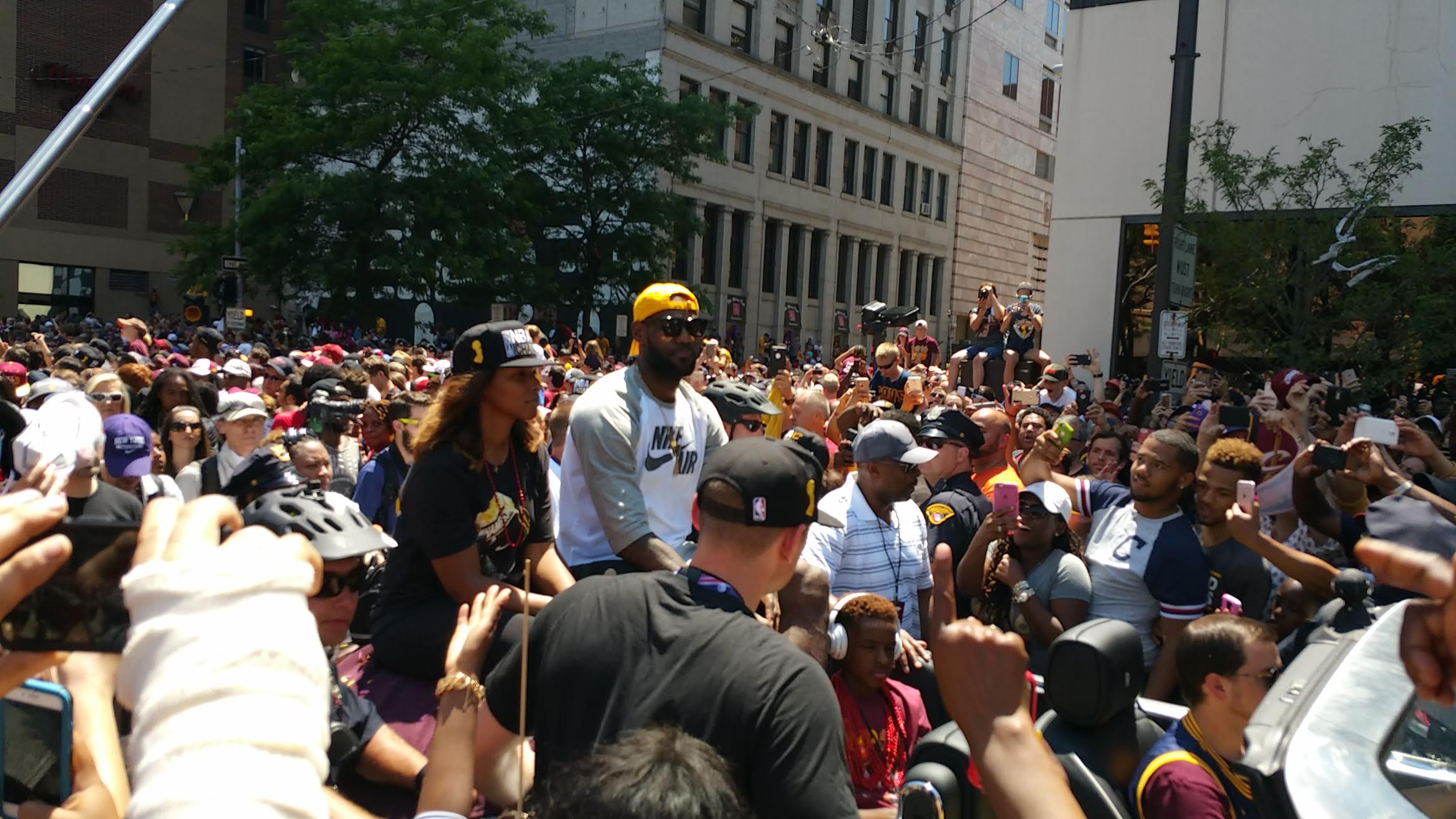 LeBron James' car travels through the throngs of adoring fans